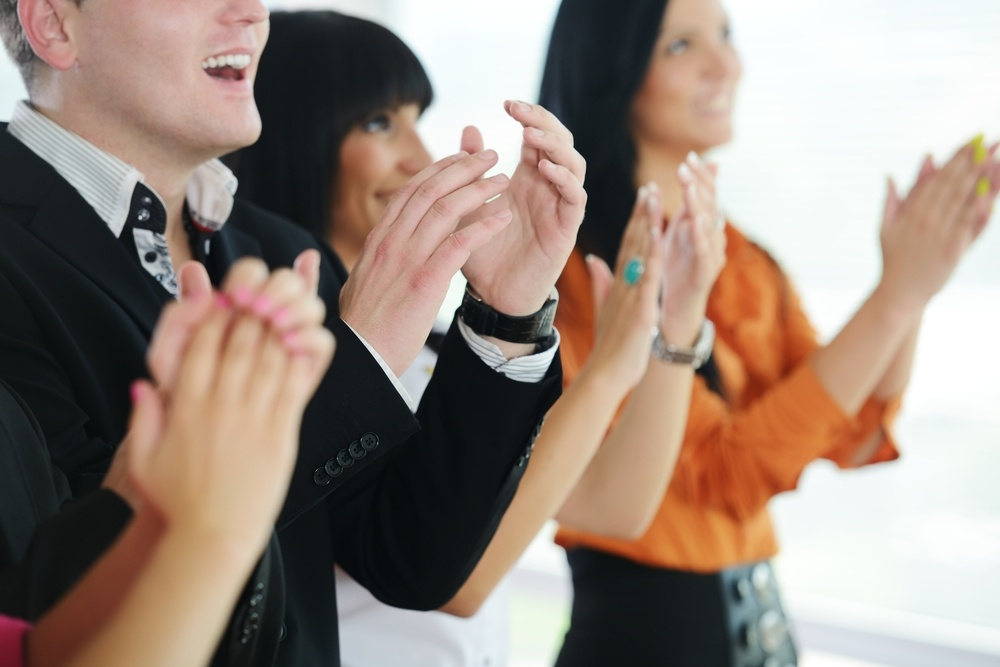 Business people clapping hands during meeting at office or presentation.jpeg