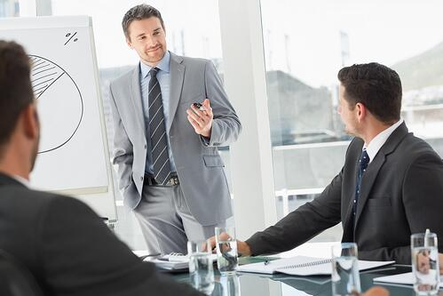 Businessman presenting new project to partners.jpeg