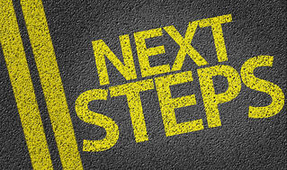 Next Steps written on the road