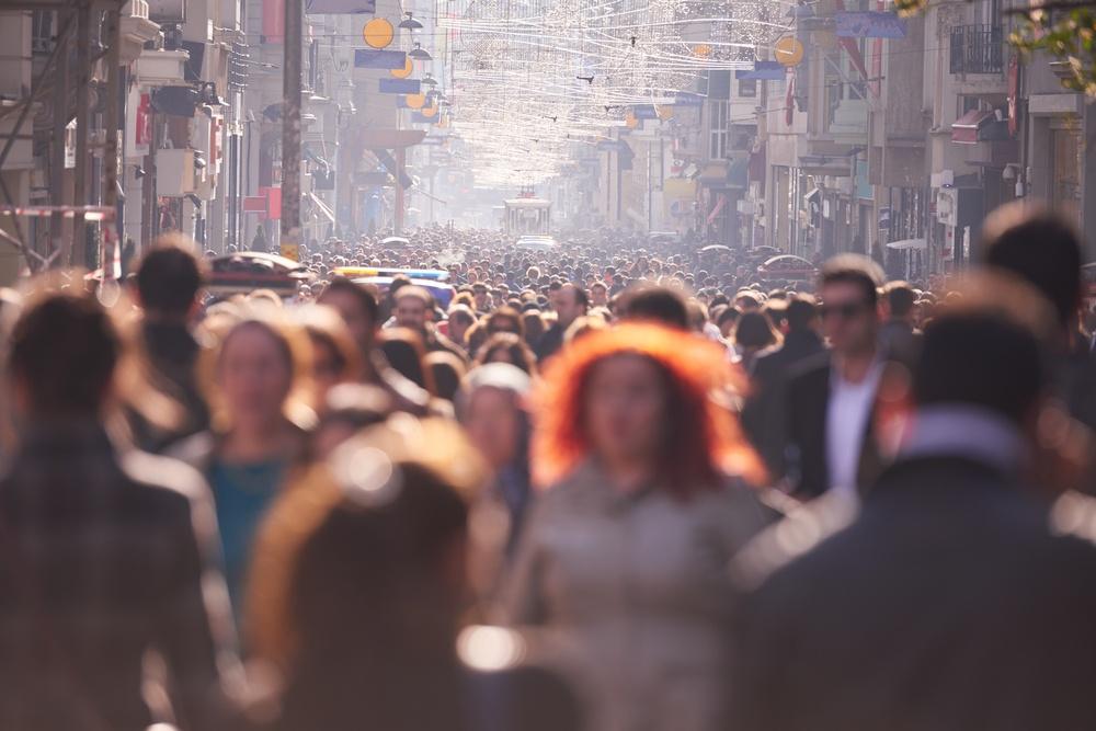people crowd walking on busy street on daytime.jpeg